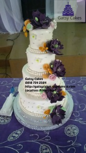 wm purple and orange flowers wedding cake